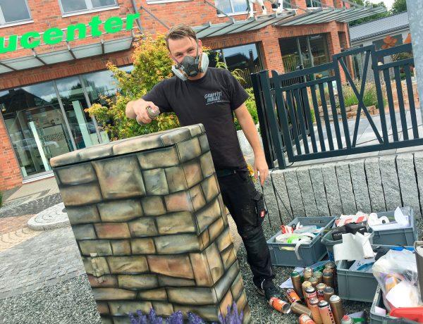 Graffiti Stromkasten Kunst Team Baucenter in Wanderup